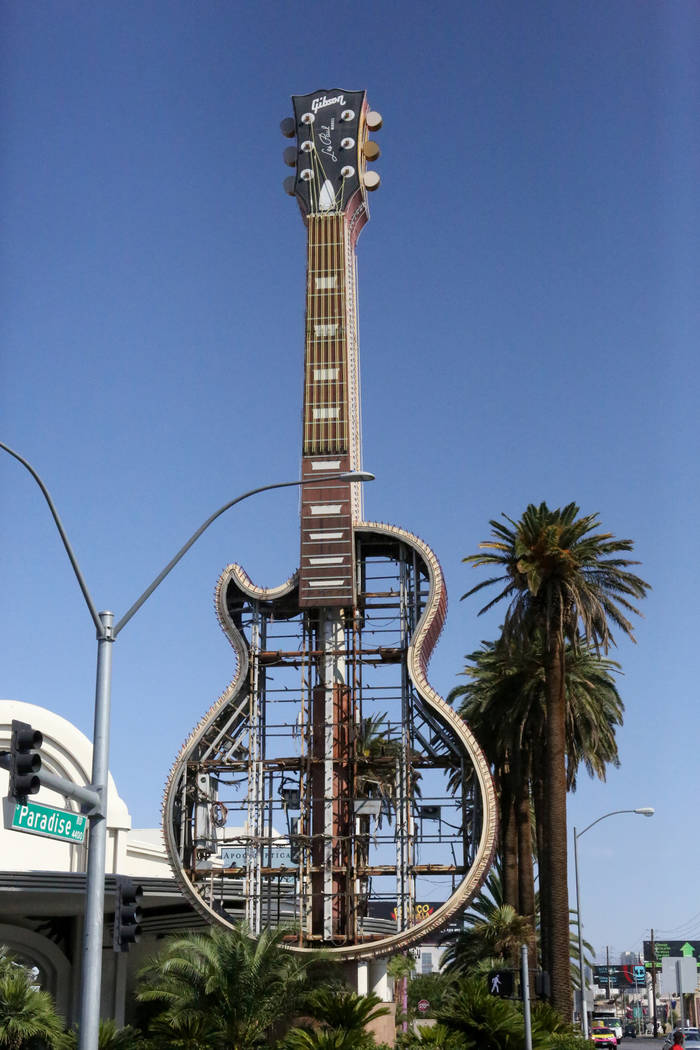 The Hard Rock Café neon sign at the corner of Harmon and Paradise is coming down and moving to its new home in the Neon Museum. Friday, September 1, 2017 Michael Quine Las Vegas Review-Journa ...