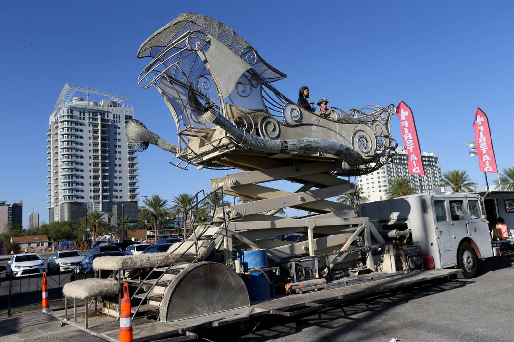 Charlie Blankenship, left, and Tomas Toulee raise BalanceVille art car into the air at First Friday in the Arts District of downtown Las Vegas June 1, 2018. The art car was on display to promote t ...