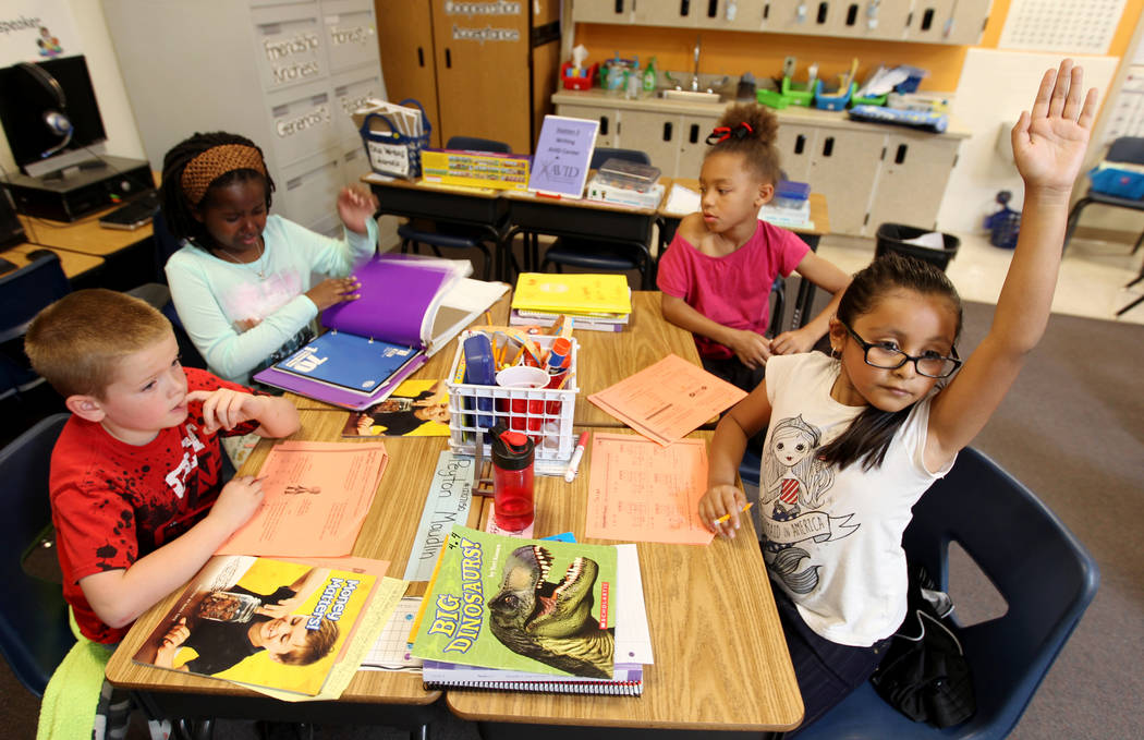 Booker Elementary School kindergarteners, from left, Peyton Maudlin, Zarina Johnson, Ya'Hynest Pope and Leah Perez-Hernandez in class, Wednesday, April 4, 2018. K.M. Cannon Las Vegas Review-Journ ...