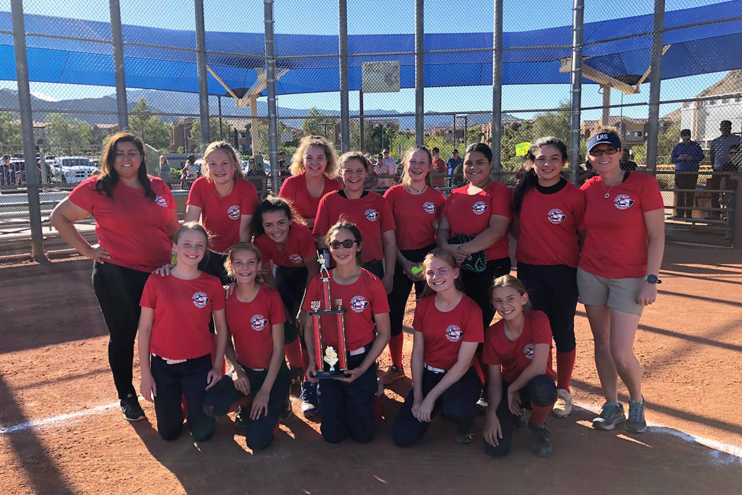 Coach Ericka Spiezio (right) and Coach Melissa Sores (left) are shown with Leavitt Middle School softball team. Carmella Korte is in the middle, holding trophy. (Keith Wipperman)