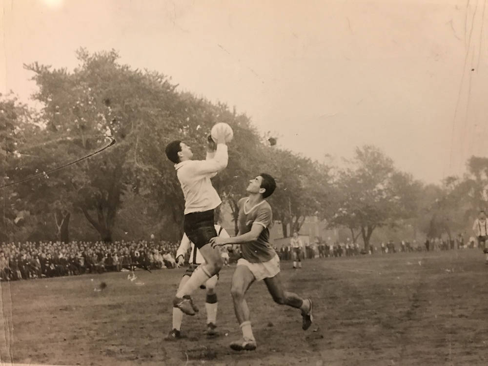 Eddy Biren handles a soccer ball during game in Montreal, playing for Canada team against team from Greece, in August 1964. (Courtesy Eddy Biren)