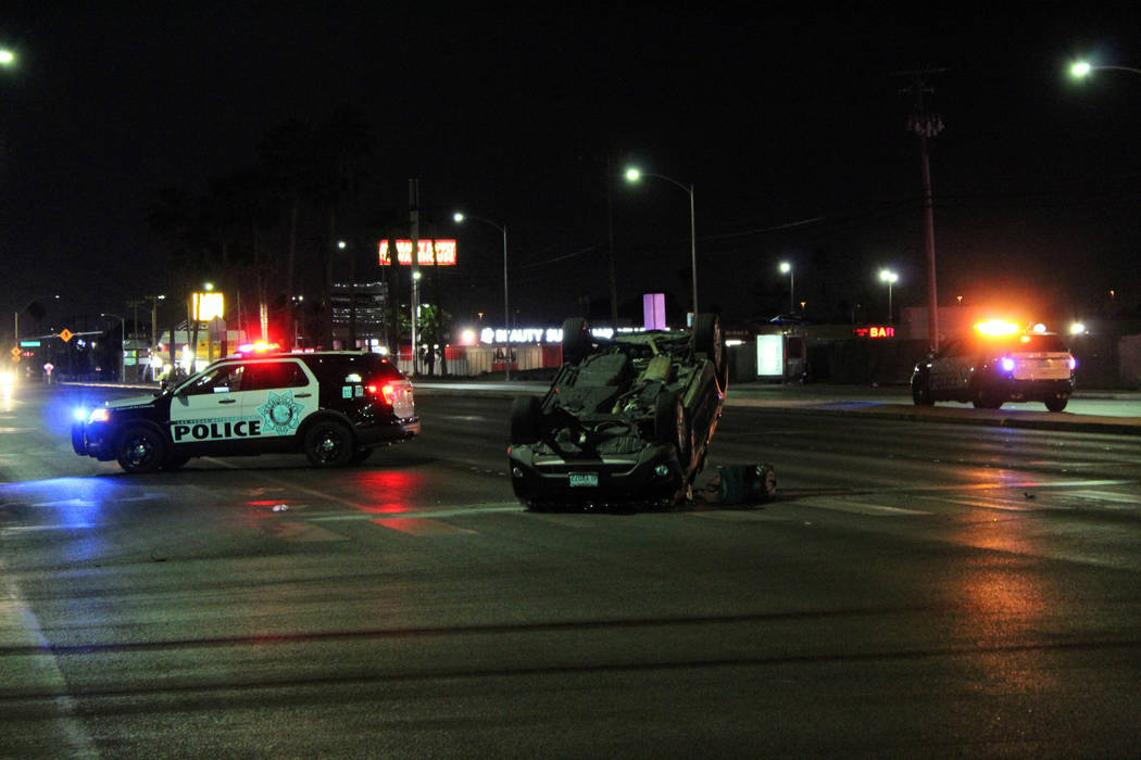 Las Vegas Police investigate a rollover crash Friday, June 1 at North Decatur Boulevard and Vegas Drive. (Max Michor/Las Vegas Review-Journal)