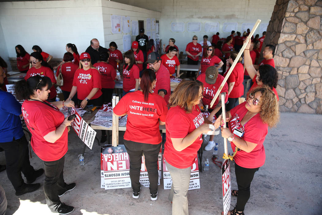 """Culinary Union organizers Ermila make strike picket signs at the newly opened """"Strike HQ"""" at the intersection of Wyoming Avenue and Fairfield Avenue in Las Vegas, Friday, June 1, 201 ..."""