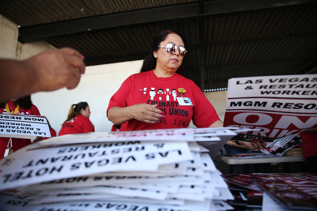 "Culinary Union organizer Ermila Medina makes strike picket signs at the newly opened ""Strike HQ"" at the intersection of Wyoming Avenue and Fairfield Avenue in Las Vegas, Friday, June ..."