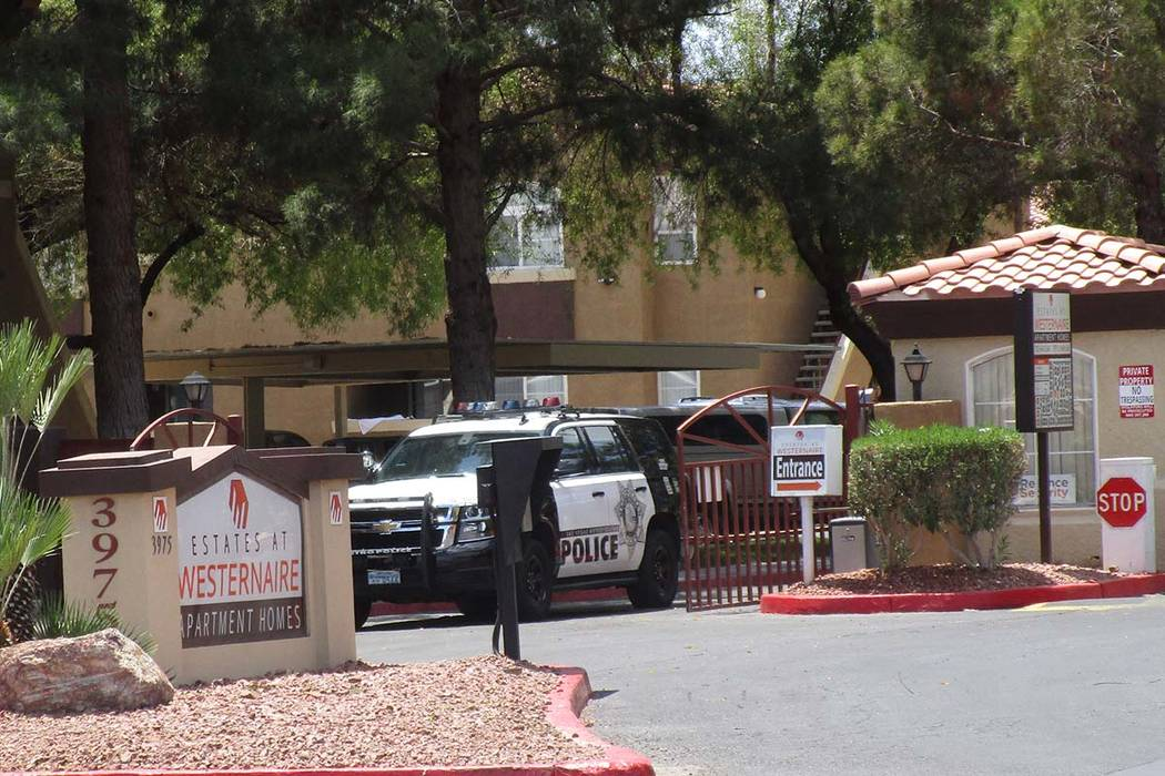 A police vehicle leaves the Estates at Westernaire Apartment Homes at 3975 N. Nellis Blvd. on Wednesday, May 30, 2018, after investigators responded to a report of a 2-year-old gunshot victim. (Gr ...