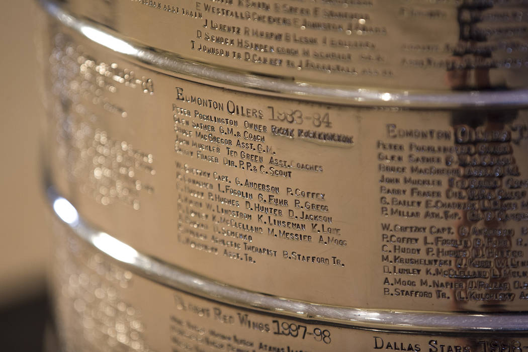 The engraving of the 1983-1984 Edmonton Oilers hockey team on the Stanley Cup on display at The Westin hotel in Las Vegas on Friday, April 6, 2018. Richard Brian Las Vegas Review-Journal @vegaspho ...