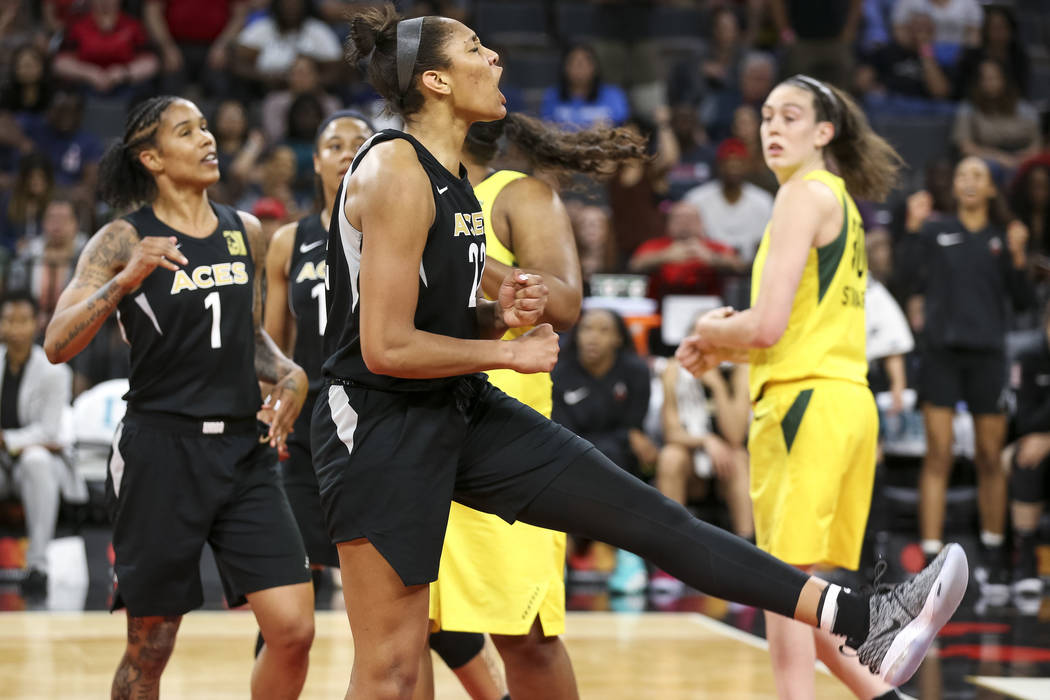 Las Vegas Aces center A'ja Wilson (22) reacts after getting fouled in the second half of a WNBA basketball game against the Seattle Storm at the Mandalay Bay Events Center in Las Vegas on Sunday, ...