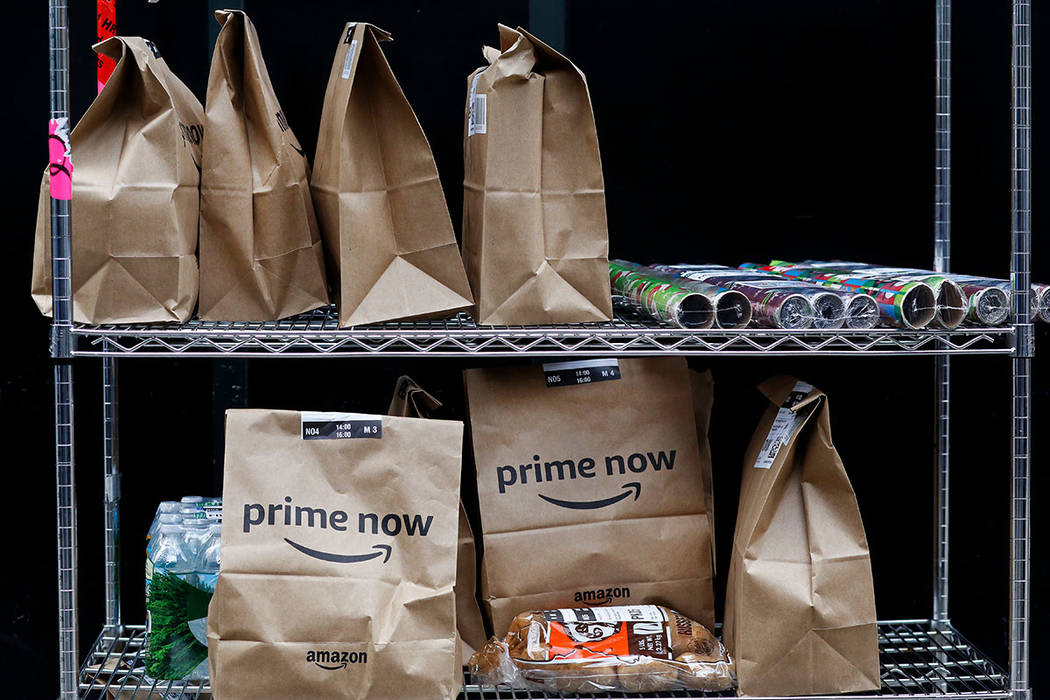 Amazon Prime Now bags are ready for delivery at the Amazon warehouse in New York. (AP Photo/Mark Lennihan, File)