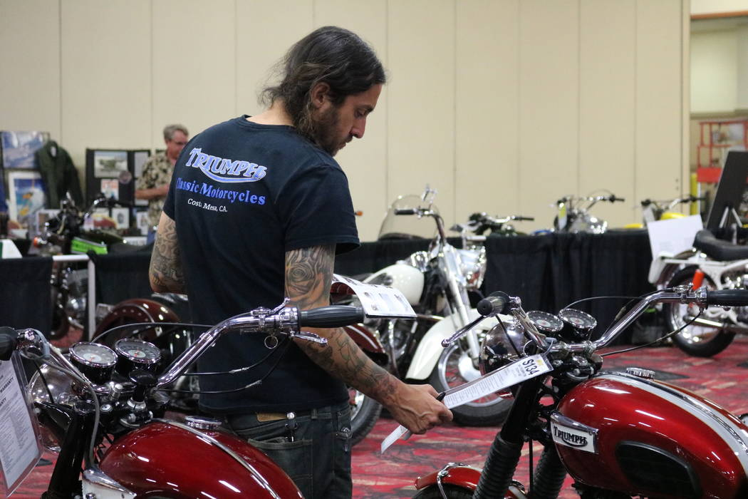 A bidder looks over a 1969 Triumph TR6 Trophy 650 motorcycle at Mecum Las Vegas Motorcycle Auction at South Point in Las Vegas, Friday, June 1, 2018. Madelyn Reese/Las Vegas Review-Journal