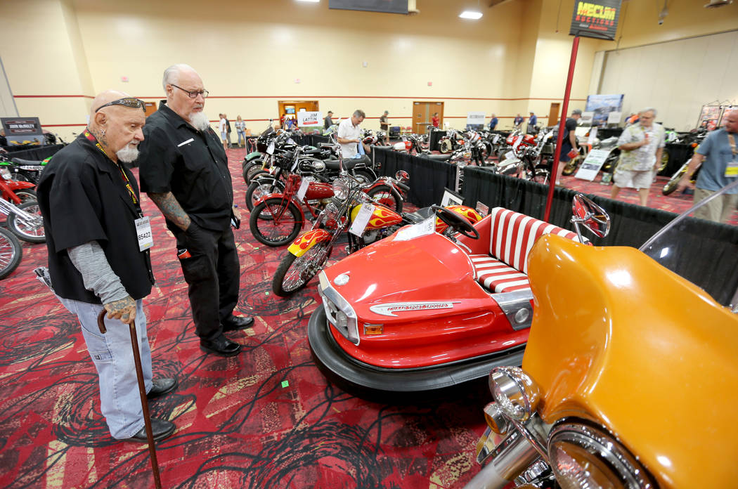 Keith Drum, left, of Anaheim and Stormy Stormoen of Las Vegas check out a 1961 Lussie Fairground Bumper Car during the Mecum Las Vegas Motorcycle Auction at the South Point Friday, June 1, 2018. K ...