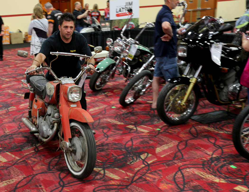 Steven Milton pushes a 1966 Honda Late Dream Touring bike during the Mecum Las Vegas Motorcycle Auction at the South Point Friday, June 1, 2018. K.M. Cannon Las Vegas Review-Journal @KMCannonPhoto