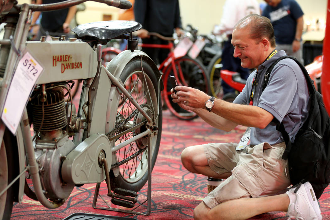 Stephen Cortesy of Costa Mesa, Calif. checks out a 1913 Harley-Davidson 9B Single bike during the Mecum Las Vegas Motorcycle Auction at the South Point Friday, June 1, 2018. K.M. Cannon Las Vegas ...