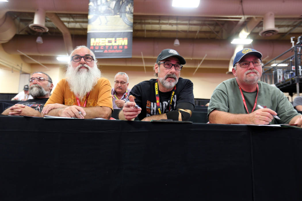Walter Sidur, from left, Ralph Sidur, Howard Lacy and Merrit Roy, all of Fresno, Calif. watch the bidding during the Mecum Las Vegas Motorcycle Auction at the South Point Friday, June 1, 2018. K.M ...