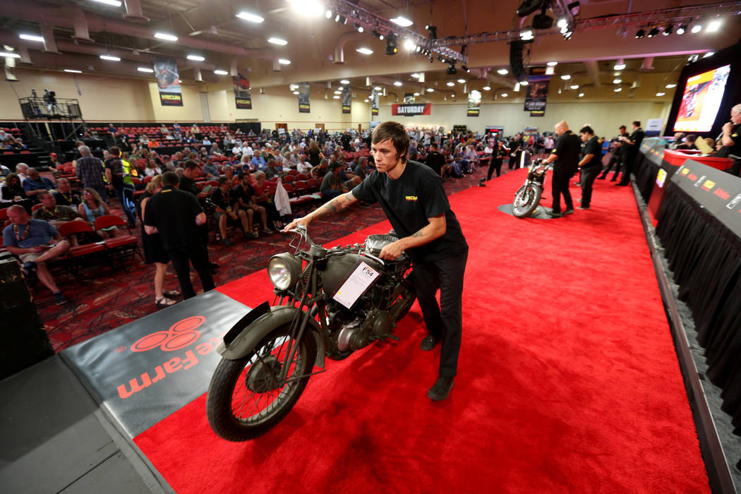 Aaron Hartley pushes a 1942 BSA M-20 during the Mecum Las Vegas Motorcycle Auction at the South Point Friday, June 1, 2018. K.M. Cannon Las Vegas Review-Journal @KMCannonPhoto