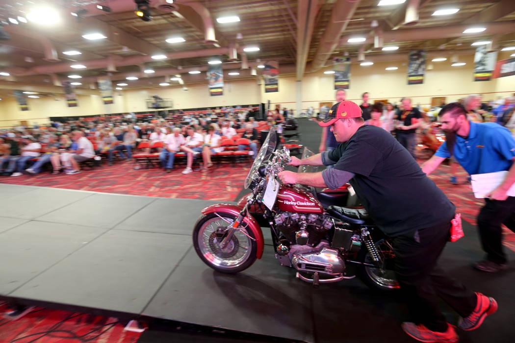 Josh Wells pushes a 1975 Harley-Davidson XLH 1000 with sidecar during the Mecum Las Vegas Motorcycle Auction at the South Point Friday, June 1, 2018. K.M. Cannon Las Vegas Review-Journal @KMCannon ...