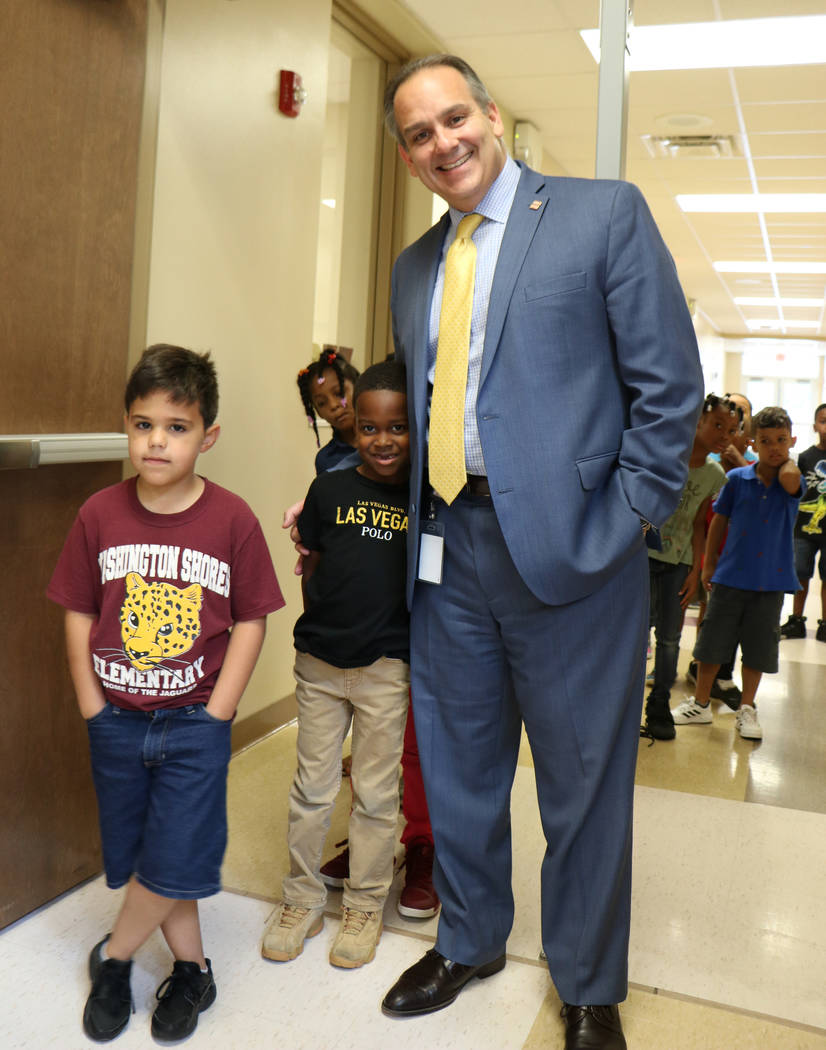 Incoming Clark County Superintendent Jesus Jara poses for a photo with Washington Shores Elementary School student Cordelroe Robinson during a tour of the Orlando school on Wednesday, May 22, 2018 ...