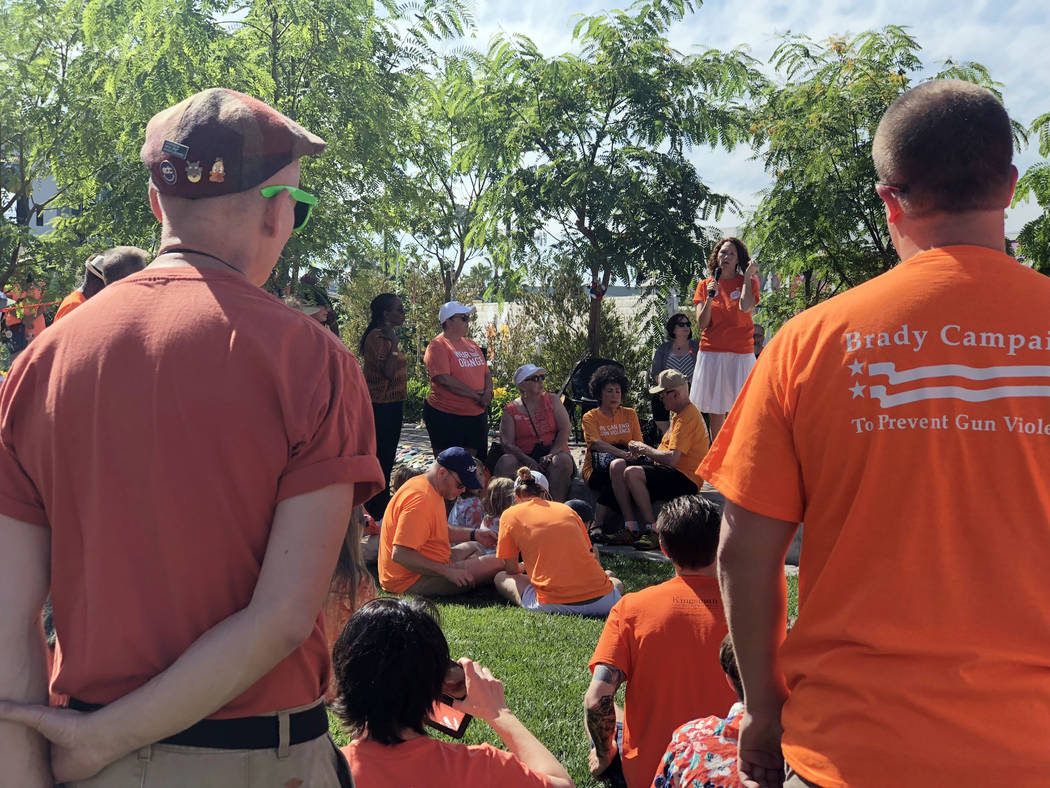 Supporters of gun reform and an end to gun violence listen to key note speakers at the Wear Orange event at the Las Vegas Community Healing Garden on Saturday, June 2, 2018. (Rio Lacanlale/Las Veg ...