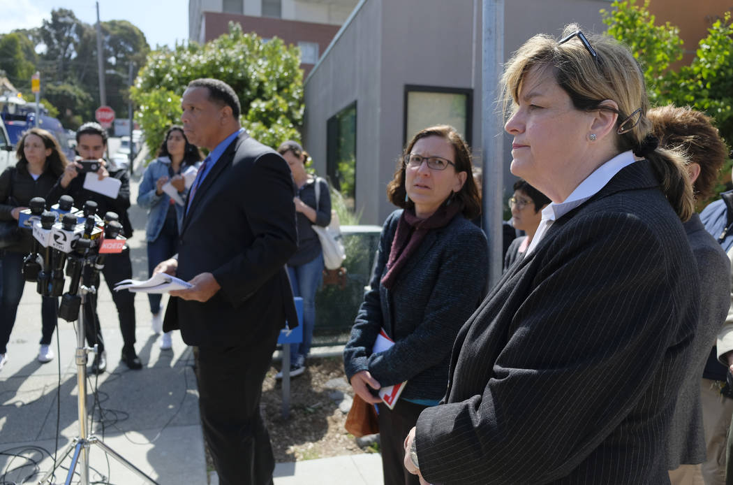 From right, San Francisco Sheriff Vicki Hennessy, hospital spokeswoman Rachael Kagan and Roland Pickens meet with reporters about a woman who was found dead in a stairwell of a power plant during ...