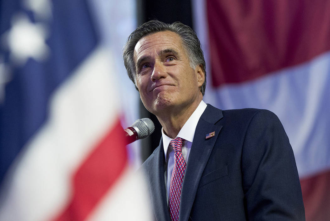 Mitt Romney delivers his speech to the delegates at the Utah Republican Nominating Convention at the Maverik Center in West Valley City, Utah, in April. (Leah Hogsten/The Salt Lake Tribune via AP, ...