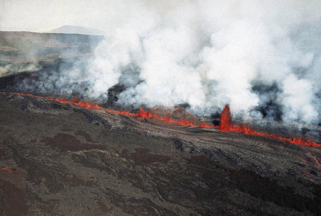 Lava erupts along Mauna Loa volcano in Hawaii in 1984. (AP Photo/Ira Schwarz, File)