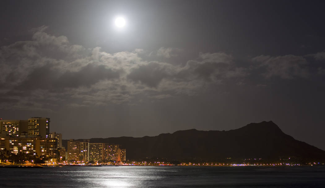 The moon lights up Waikiki and Diamond Head in Honolulu in 2012. (AP Photo/Eugene Tanner, File)