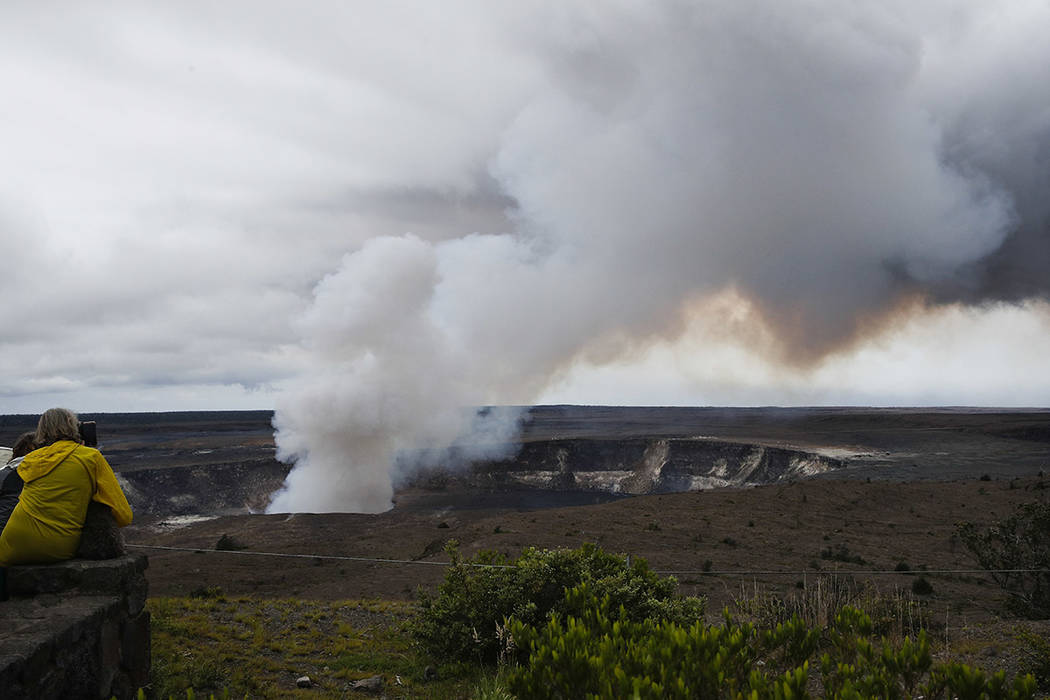 Steam and gas rise from Kilauea's summit crater in Hawaii Volcanoes National Park, Hawaii, last month. (AP Photo/Jae C. Hong, File)
