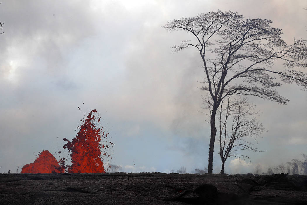 Lava erupts from Kilauea volcano's fissures in the Leilani Estates subdivision near Pahoa, Hawaii, last month. (AP Photo/Jae C. Hong, File)