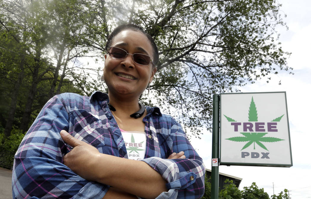 Tree PDX marijuana shop owner Brooke Smith poses for a photo outside her small shop in Portland, Ore., last month. (AP Photo/Don Ryan)