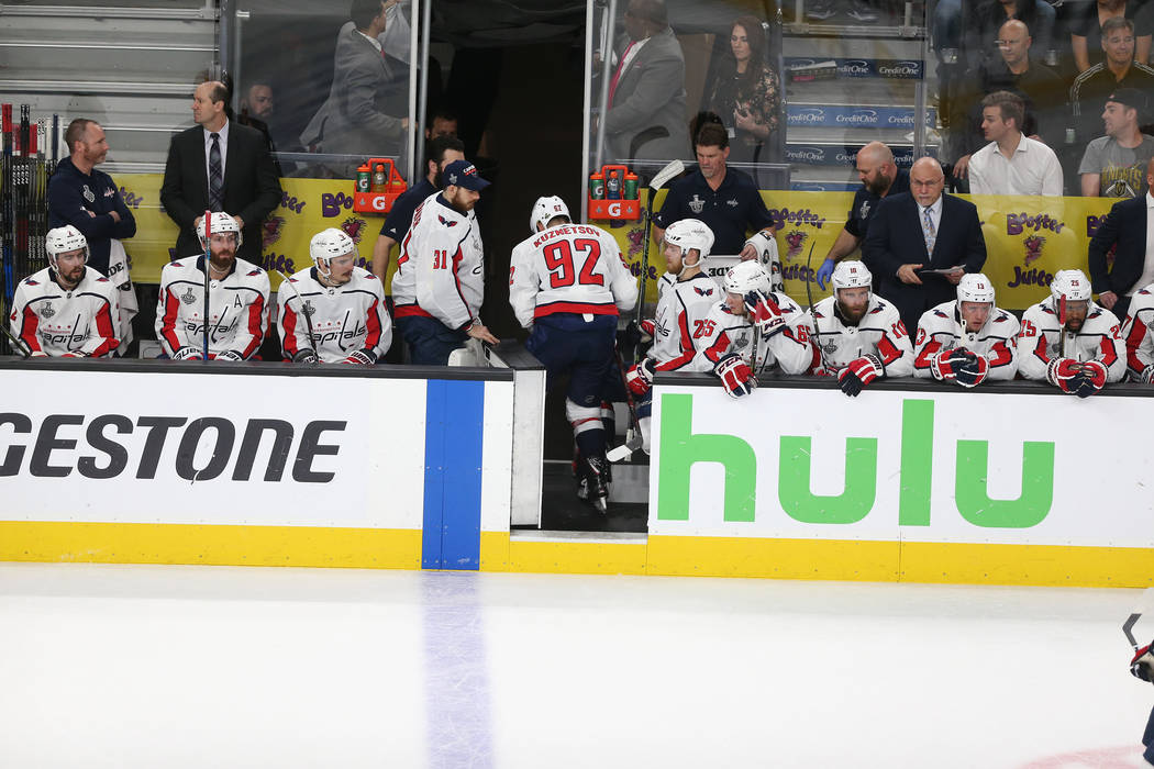 4dd95064680 Washington Capitals center Evgeny Kuznetsov (92) leaves the ice after taking  a hit against