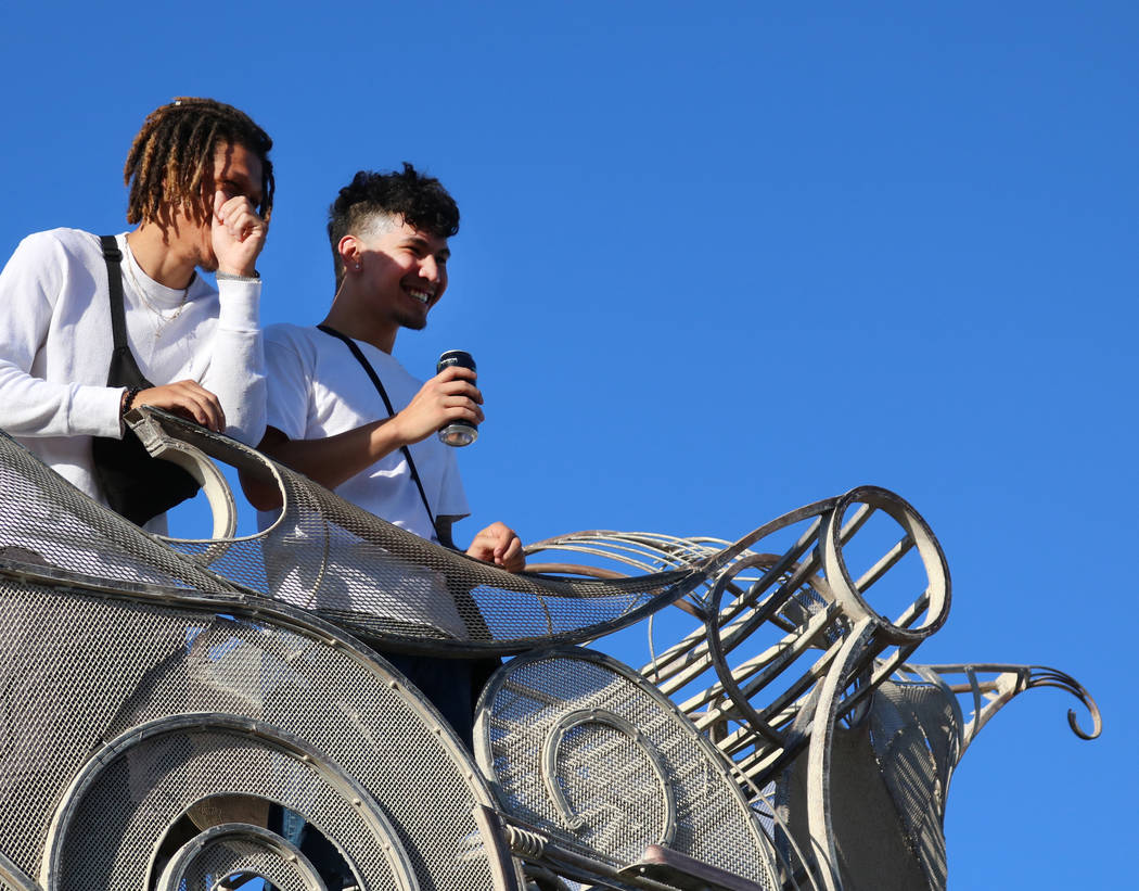 Riders look down on First Friday festivities from onboard BalanceVille, an art car on display in Las Vegas, Friday, June 1, 2018. BalanceVille is capable of ascending 50 feet in the air with multi ...
