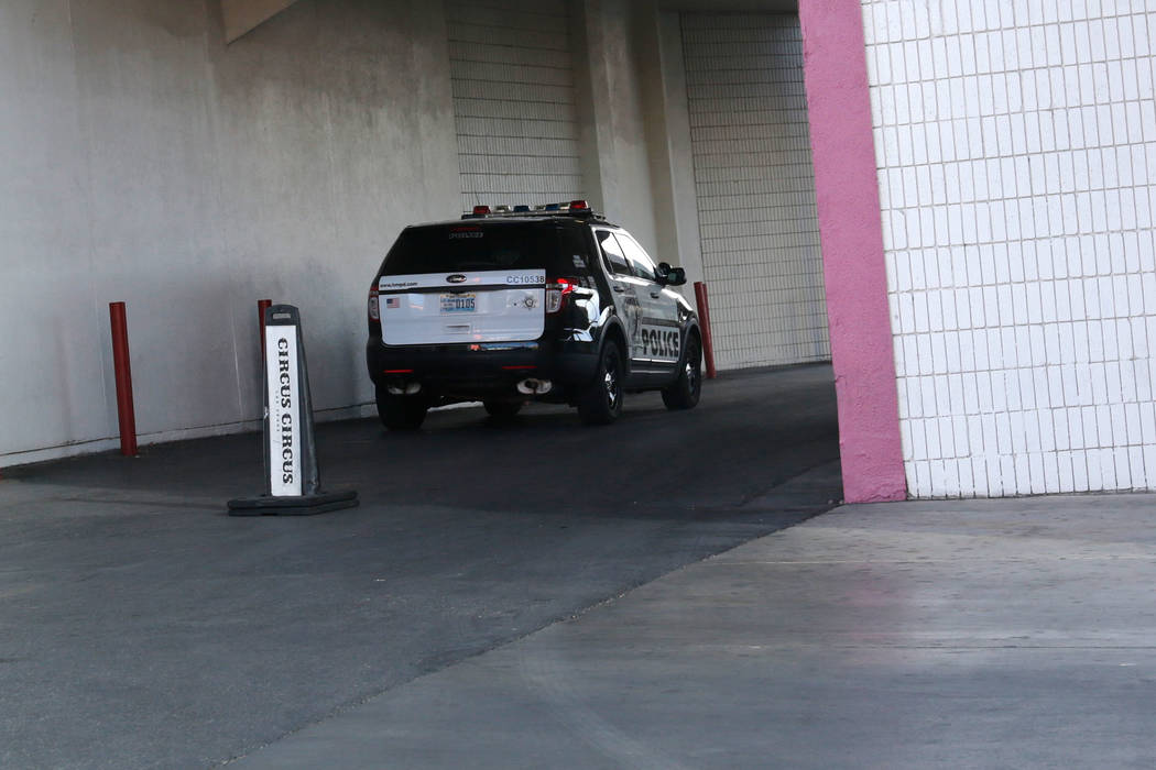A police car is parked at the side of the Circus Circus in Las Vegas, Friday, June 1, 2018. Las Vegas police are investigating the deaths of two people inside a Circus Circus hotel room Friday ev ...