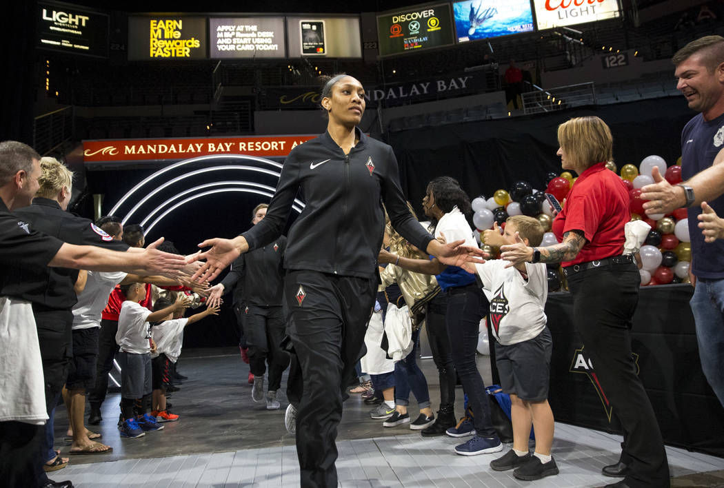 Las Vegas Aces center A'ja Wilson (22) is introduced before playing the Washington Mystics in a WNBA basketball game at the Mandalay Bay Events Center in Las Vegas on Friday, June 1, 2018. Richard ...