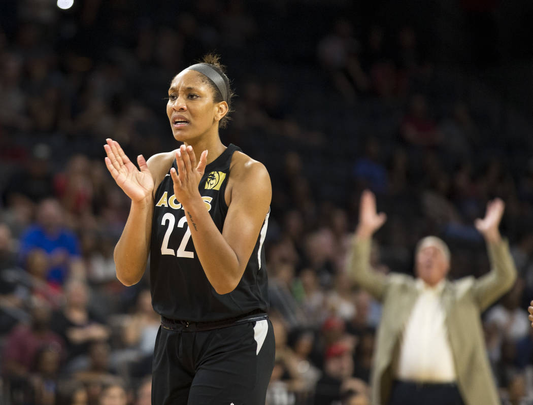 Las Vegas Aces center A'ja Wilson (22) reacts to a play against the Washington Mystics in the first half of a WNBA basketball game at the Mandalay Bay Events Center in Las Vegas on Friday, June 1, ...