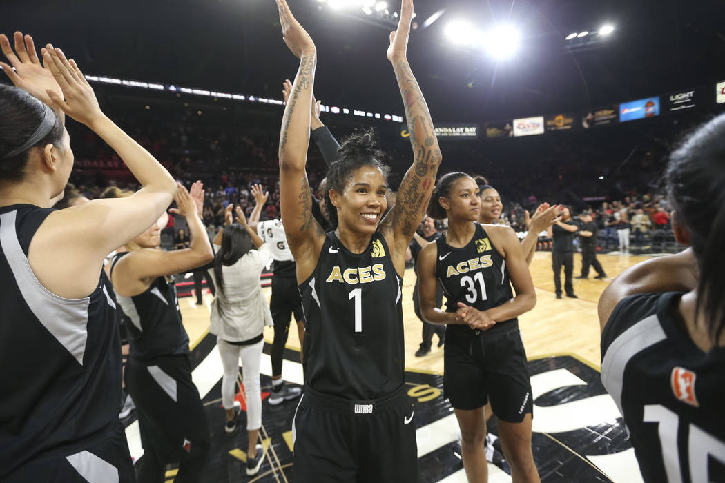 Las Vegas Aces forward Tamera Young (1) celebrates the teams 85-73 victory over the Washington Mystics following a WNBA basketball game at the Mandalay Bay Events Center in Las Vegas on Friday, Ju ...