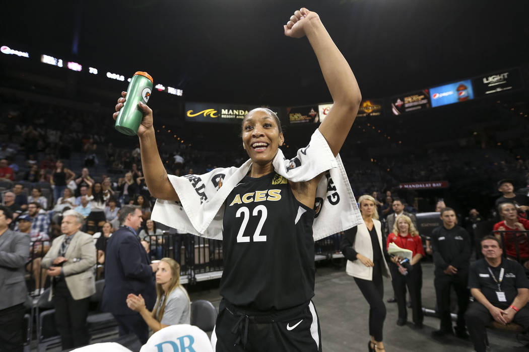 Las Vegas Aces center A'ja Wilson (22) celebrates the teams 85-73 victory over the Washington Mystics following a WNBA basketball game at the Mandalay Bay Events Center in Las Vegas on Friday, Jun ...