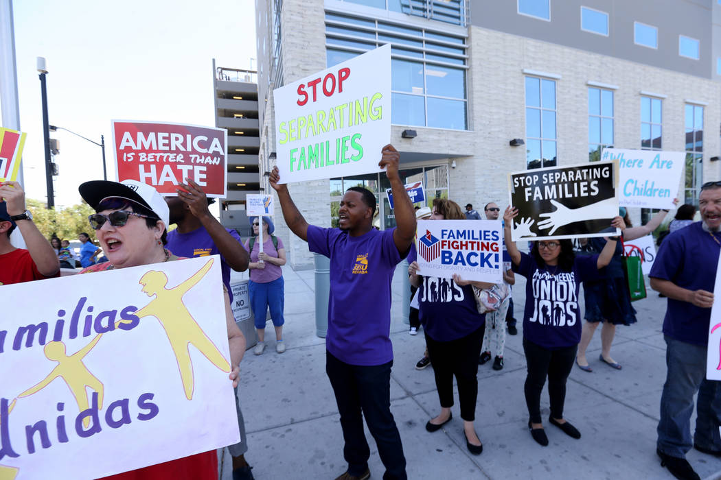 Protesters including Jan Steckel, left, and William McCurdy II chant during a National Day of Action protest outside the Federal Justice Tower where U.S. Immigration and Customs Enforcement has of ...
