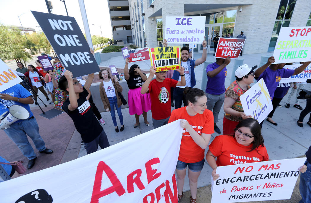 Protesters chant during a National Day of Action protest outside the Federal Justice Tower where U.S. Immigration and Customs Enforcement has offices Friday, June 1, 2018. Several organizations or ...