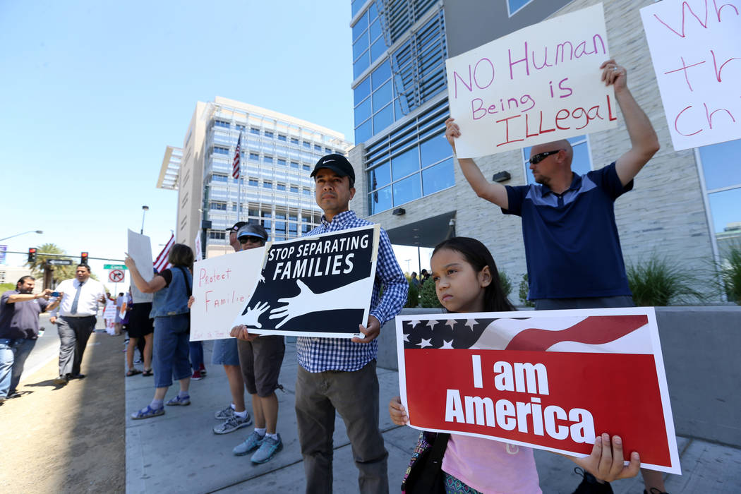 Protesters including Cammy Castillo, 9, and her father Antonio during a National Day of Action protest outside the Federal Justice Tower where U.S. Immigration and Customs Enforcement has offices ...