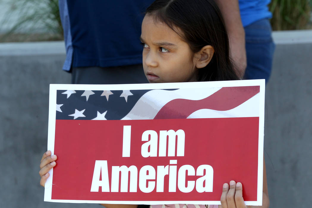 Protesters including Cammy Castillo, 9, during a National Day of Action protest outside the Federal Justice Tower where U.S. Immigration and Customs Enforcement has offices Friday, June 1, 2018. S ...