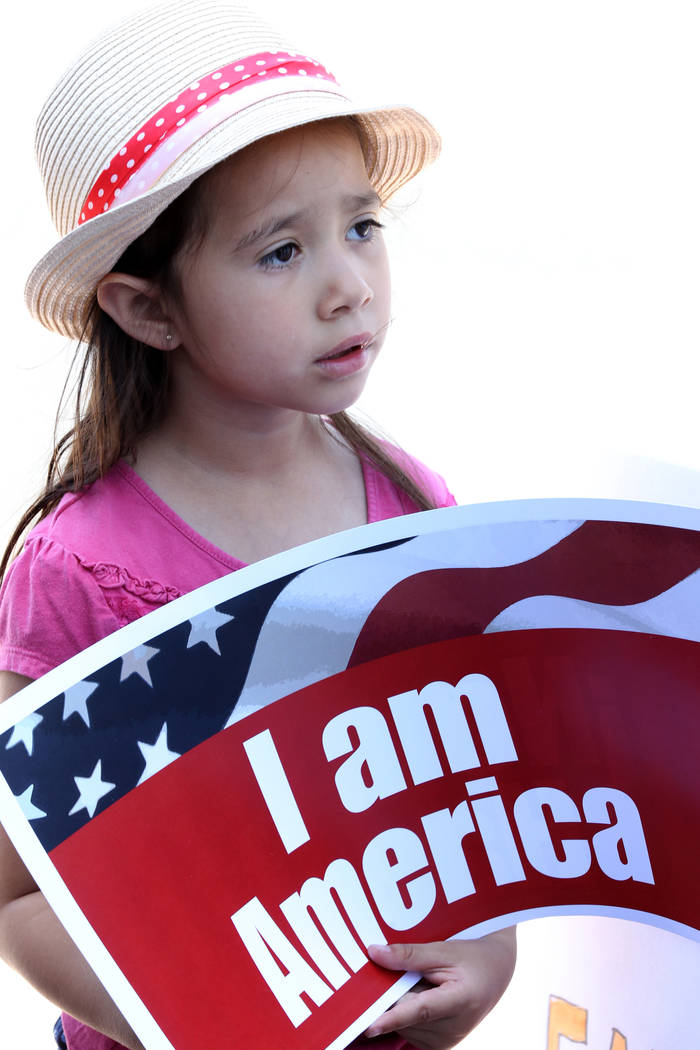 Protesters including Nayeli Guevara, 6, during a National Day of Action protest outside the Federal Justice Tower where U.S. Immigration and Customs Enforcement has offices Friday, June 1, 2018. S ...