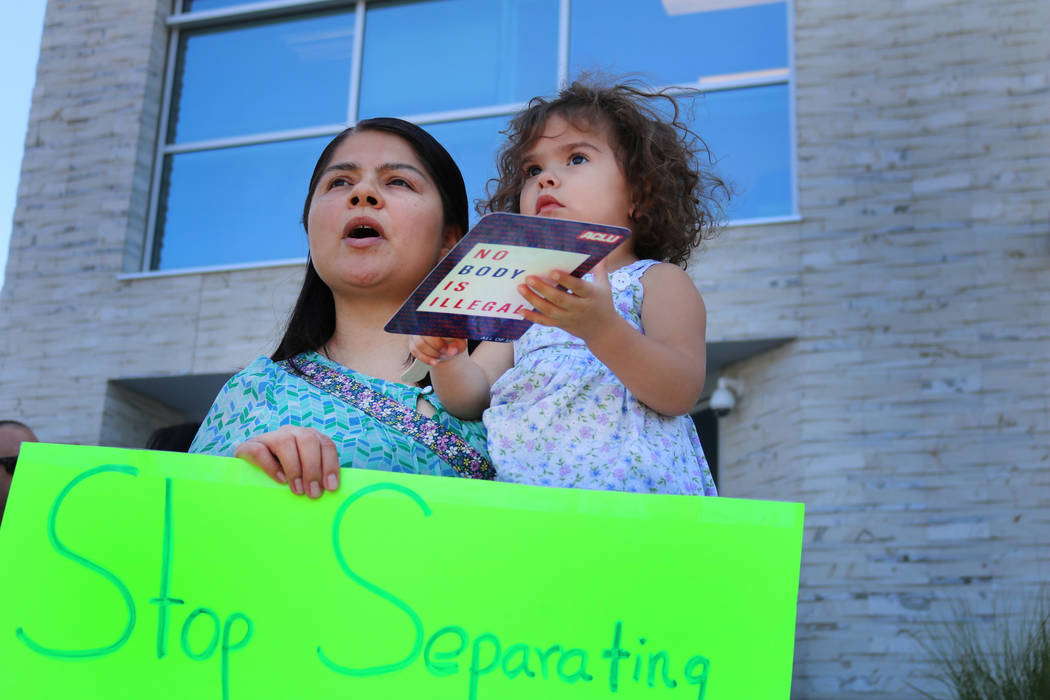 Ireri Bravo, left and Elena Bravo, right, participate in a protest outside the Federal Justice Tower, where Immigration and Customs Enforcement officials have offices, in Las Vegas, Friday, June 1 ...