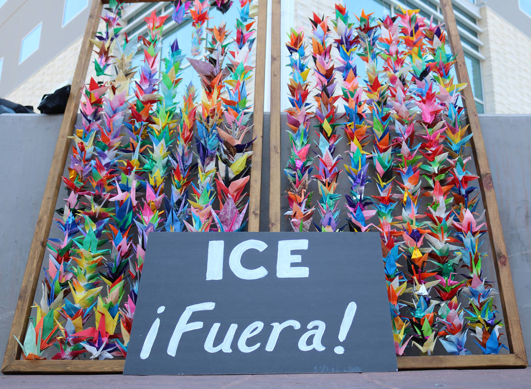 """A sign reading """"ICE Fuera"""" or """"ICE Get Out"""" sits outside the Federal Justice Tower, where Immigration and Customs Enforcement officials have offices, in Las Vegas, Friday, June ..."""