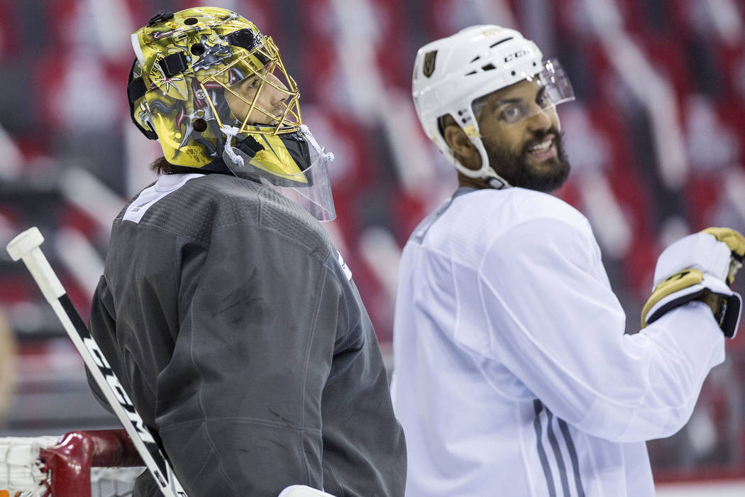 Golden Knights goaltender Marc-Andre Fleury (29) and right wing Pierre-Edouard Bellemare (41) joke around during practice leading up to Game 3 of the NHL Stanley Cup Final with the Washington Capi ...