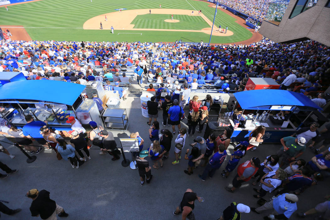 A concession stand line stretches into the covered concourse area during a game between the Chicago Cubs and the Cincinnati Reds at Cashman Field in Las Vegas on Sunday, March 26, 2017. (Brett Le ...