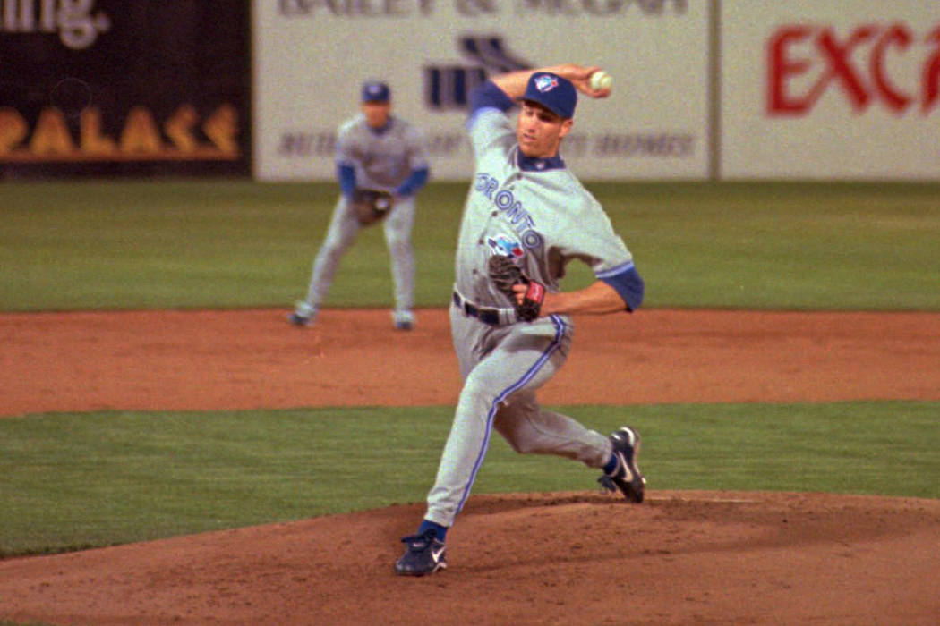 Toronto Blue Jays starting pitcher Erik Hanson pitches to an Oakland Athletics batter in the first inning, Monday night, April 1, 1996 at Cashman Field in Las Vegas. Hanson was credited with win d ...