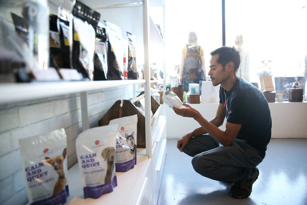 Chris Marroquin of Las Vegas browses the newly opened KANA Modern Apothecary hemp shop in downtown Las Vegas, Friday, June 1, 2018. Erik Verduzco Las Vegas Review-Journal @Erik_Verduzco