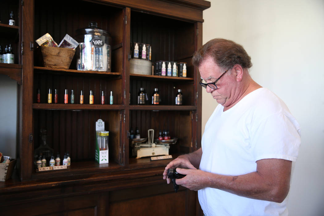 Skip Fisher of Las Vegas browses the newly opened KANA Modern Apothecary hemp shop in downtown Las Vegas, Friday, June 1, 2018. Erik Verduzco Las Vegas Review-Journal @Erik_Verduzco