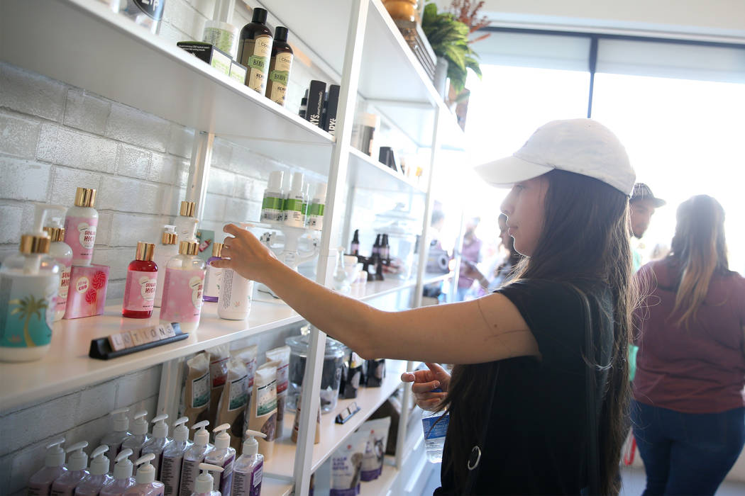 Karen Salazar of Las Vegas browses the newly opened KANA Modern Apothecary hemp shop in downtown Las Vegas, Friday, June 1, 2018. Erik Verduzco Las Vegas Review-Journal @Erik_Verduzco