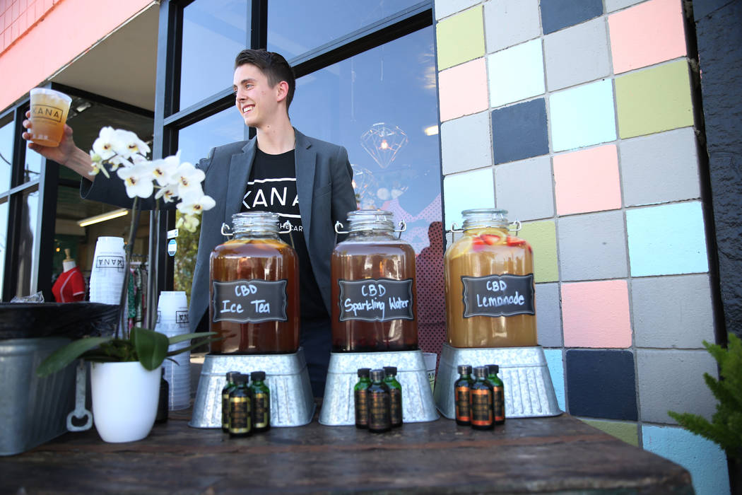 Noah Lawrence serves CBD infused mocktails during the KANA Modern Apothecary hemp shop grand opening in downtown Las Vegas, Friday, June 1, 2018. Erik Verduzco Las Vegas Review-Journal @Erik_Verduzco