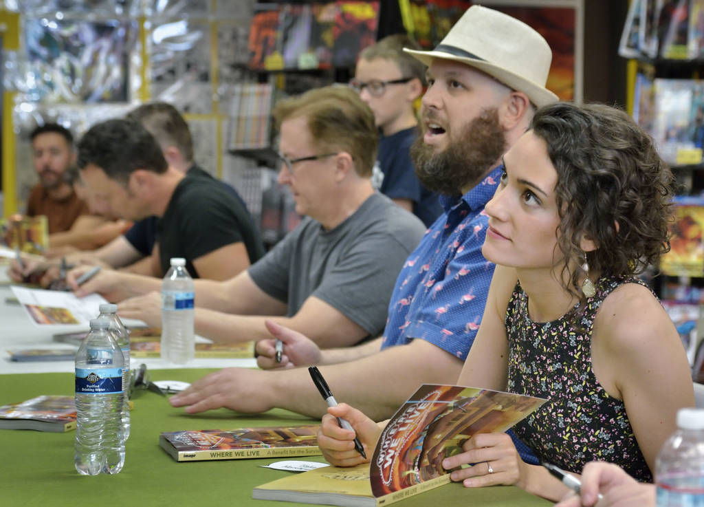Talia Hershewe, right, and Jason Harris are shown with other artists and writers during a book launch and signing for ÒWhere We Live,Ó a comic book anthology dealing with the Route 91 Ha ...